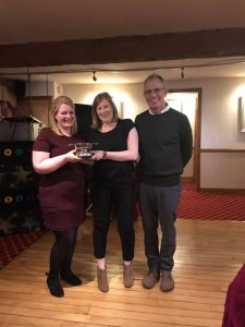 The Alison Baugh Memorial Trophy presented to Dawn Marshall and Mari Jones by David Baugh